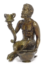 A BRONZE FIGURE OF A SATYR