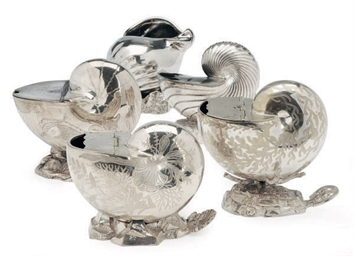 NINETEEN SILVER-PLATED SHELL-F