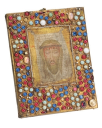 A GILT METAL MOUNTED ICON OF T