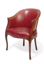 A MAHOGANY AND UPHOLSTERED LIB