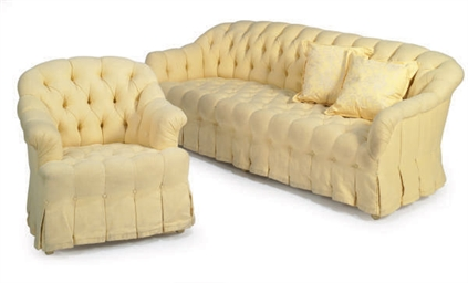 A YELLOW BUTTON-TUFTED SOFA AN