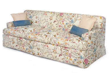 A QUILT UPHOLSTERED SOFA,