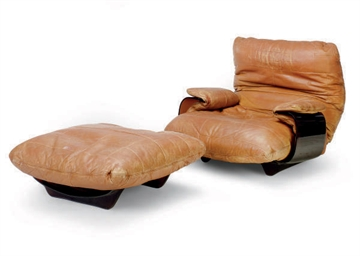 A BROWN LEATHER LOW LOUNGE CHA