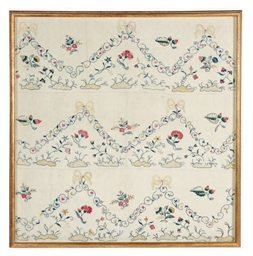 A FRAMED EMBROIDERED LINEN COV