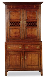AN ENGLISH OAK CABINET,
