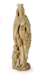 A CARVED LIMEWOOD FIGURE OF SA