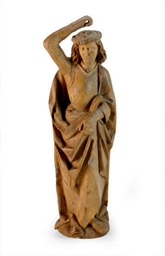 A CARVED FRUITWOOD FIGURE OF S