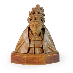 A CARVED WALNUT HEAD OF A BISH