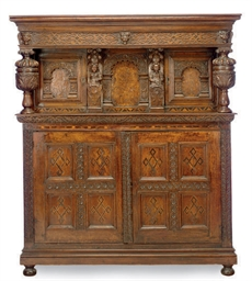 AN ENGLISH OAK COART CUPBOARD,