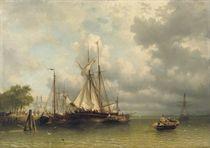 Sailing boats moored at a busy quay