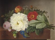A bouquet of flowers on a marble ledge
