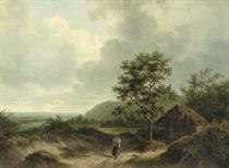 A peasant on a sandy path