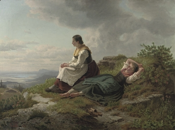 Two women resting on a mountai