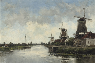 Windmills by a river