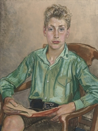 A young boy seated in a chair