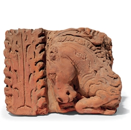 A TERRACOTTA FRAGMENT WITH HOR