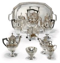 A SEVEN-PIECE SILVER VASE-SHAPED TEA AND COFFEE SERVICE WITH TRAY