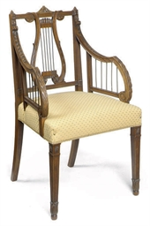 A CARVED SATINWOOD ARMCHAIR