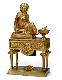 A FRENCH GILT BRONZE CHENET