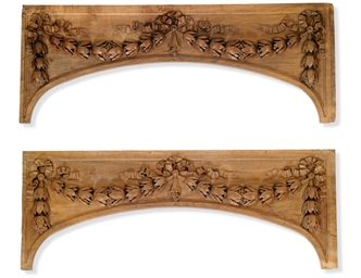 A PAIR OF CARVED WALNUT OVERDO