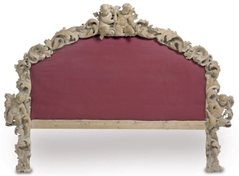 AN ITALIAN CARVED PINE BED-HEA