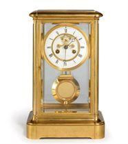 A FRENCH GILT-BRASS STRIKING FOUR GLASS MANTEL CLOCK