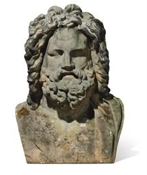 A LARGE SANDSTONE BUST OF ZEUS