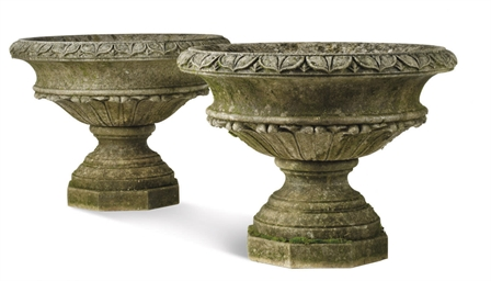 A PAIR OF LARGE LIMESTONE URNS