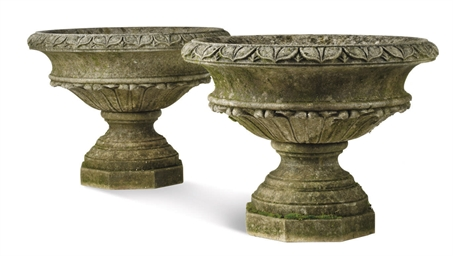 A PAIR OF LIMESTONE URNS