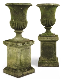 A PAIR OF SANDSTONE CAMPANA UR