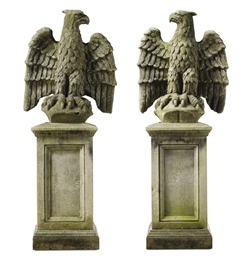 A PAIR OF COMPOSITION STONE EA
