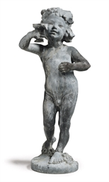 A LEAD FIGURE OF A BOY HOLDING