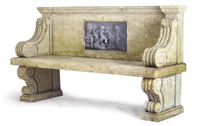 A CARVED LIMESTONE GARDEN SEAT
