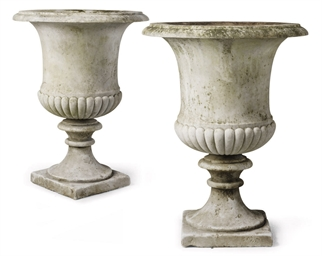 A PAIR OF MARBLE URNS