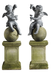 A PAIR OF LEAD WINGED PUTTI
