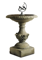A COMPOSITE STONE BIRD BATH