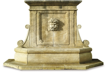 A LIMESTONE WALL FOUNTAIN