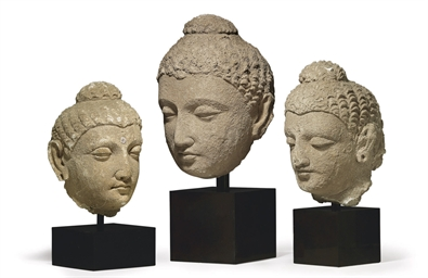 A Group of Three Stucco Heads