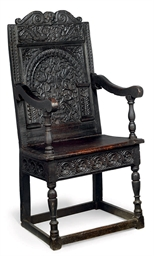 A JAMES I PAINTED ARMCHAIR