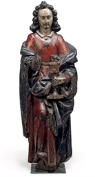 A FLEMISH PAINTED OAK FIGURE O