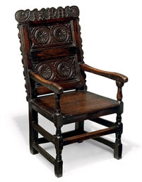 A QUEEN ANNE OAK ARMCHAIR