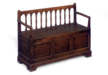 A GEORGE II OAK BOX-SEAT SETTL