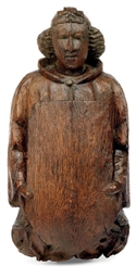 A LATE MEDIEVAL CARVED OAK FIG