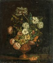 Roses, chrysanthemums, and other flowers in a sculpted copper urn, on a stone ledge
