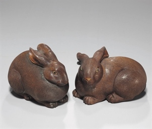 A pair of carved wood rabbits