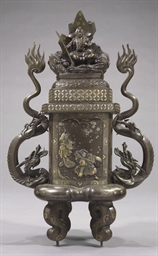 A cast bronze incense burner (