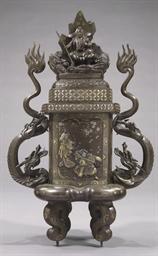 A cast bronze incense burner (