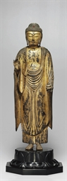 A standing wood figure of Yaku