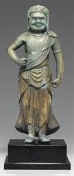 A standing bronze figure of Fu