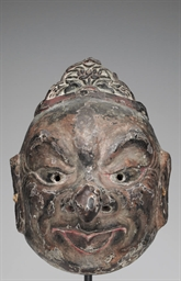 A wood Gigaku mask with crown